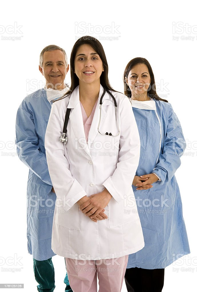 Medical surgical team with female doctor in the front royalty-free stock photo