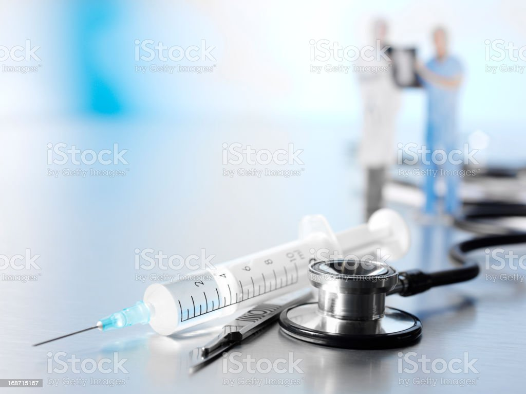 Medical Syringe and Stethoscope royalty-free stock photo