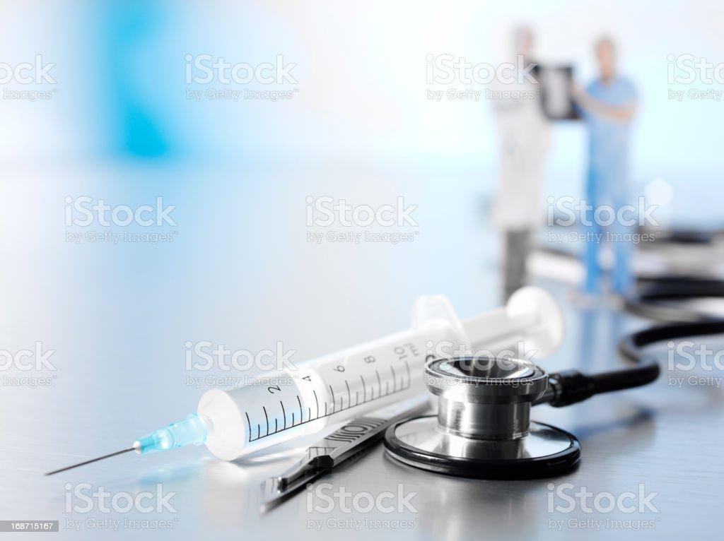 Medical Syringe and Stethoscope stock photo