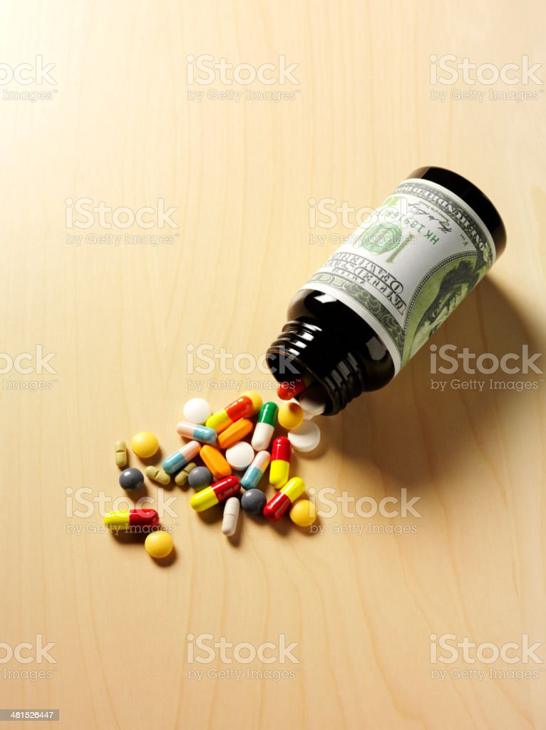 Medical Tablets and Pills with American Dollars stock photo