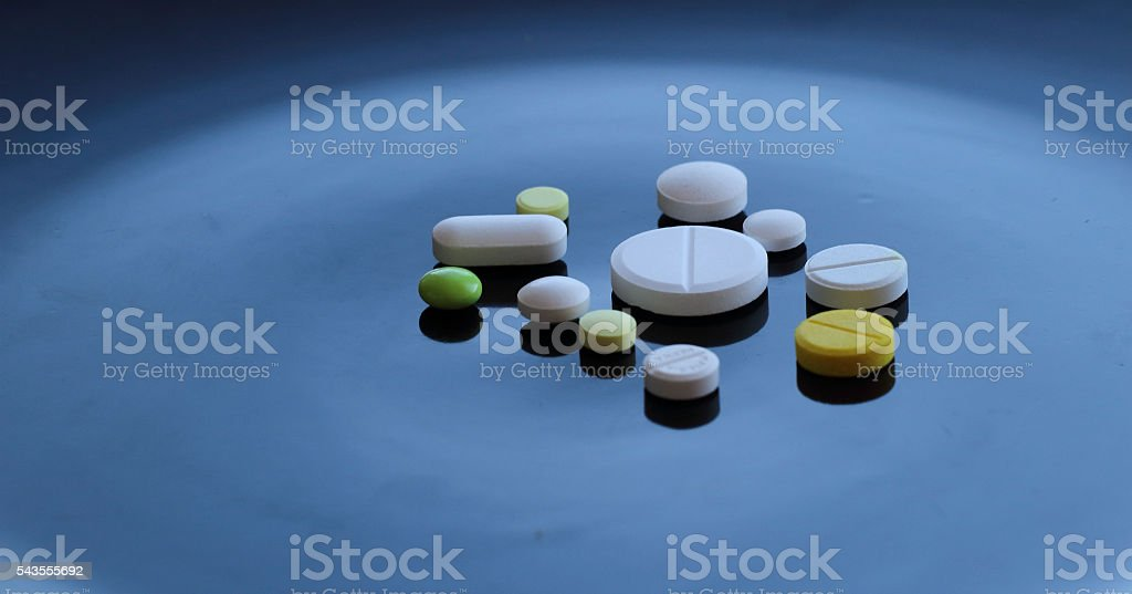 Medical tablets design. Variety colored drug pills isolated stock photo