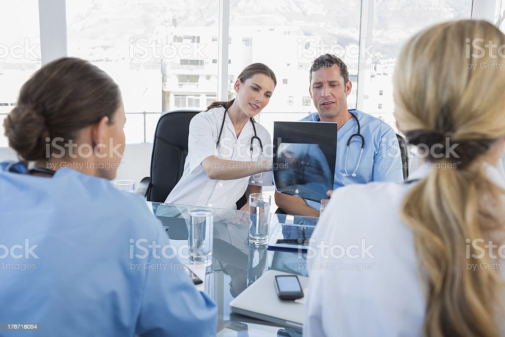 Medical team analysing a x-ray royalty-free stock photo