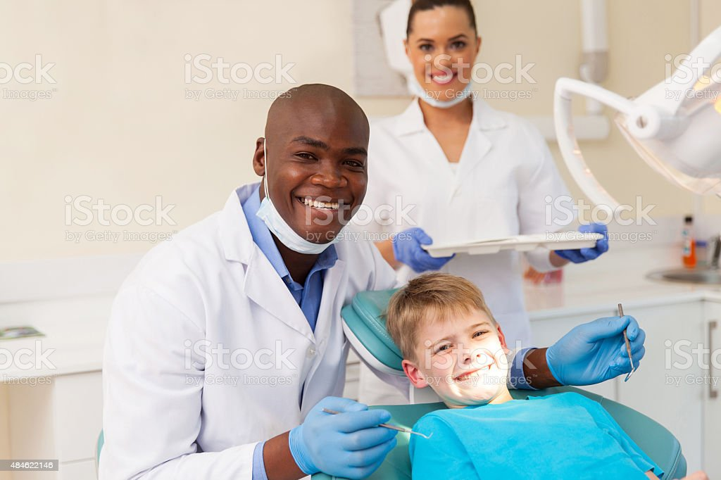 medical team and young patient stock photo