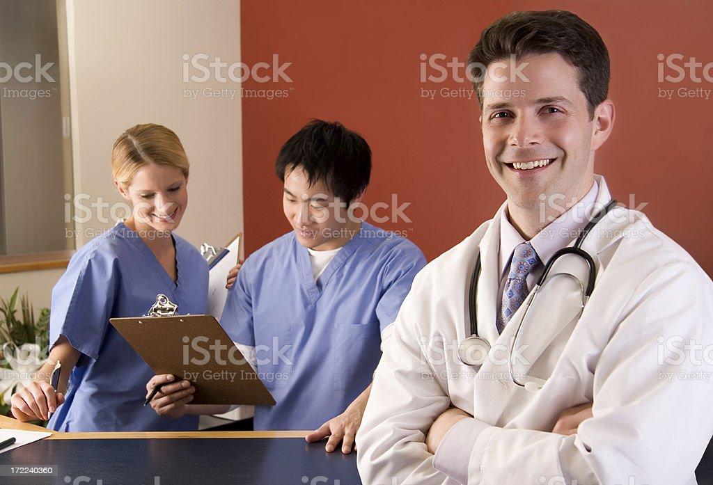 Medical Team at Nurse's Station stock photo