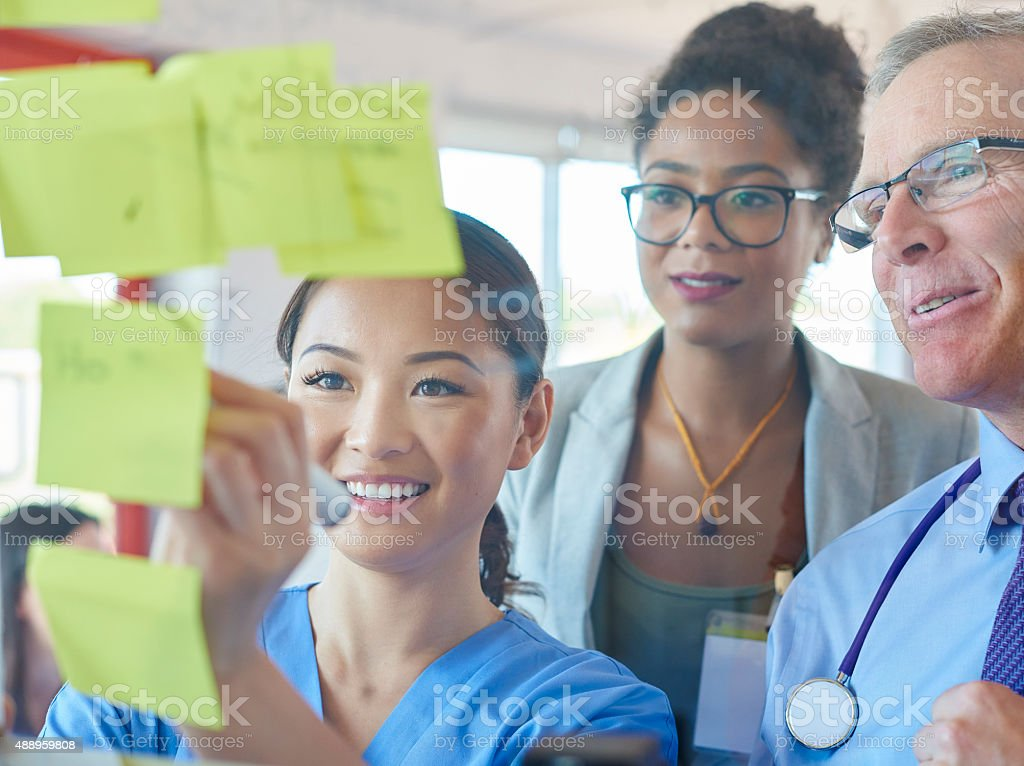 medical team brainstorming stock photo