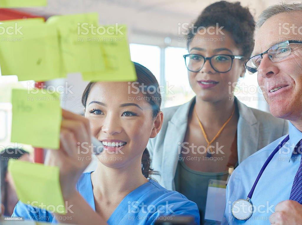 medical team brainstorming stock photo