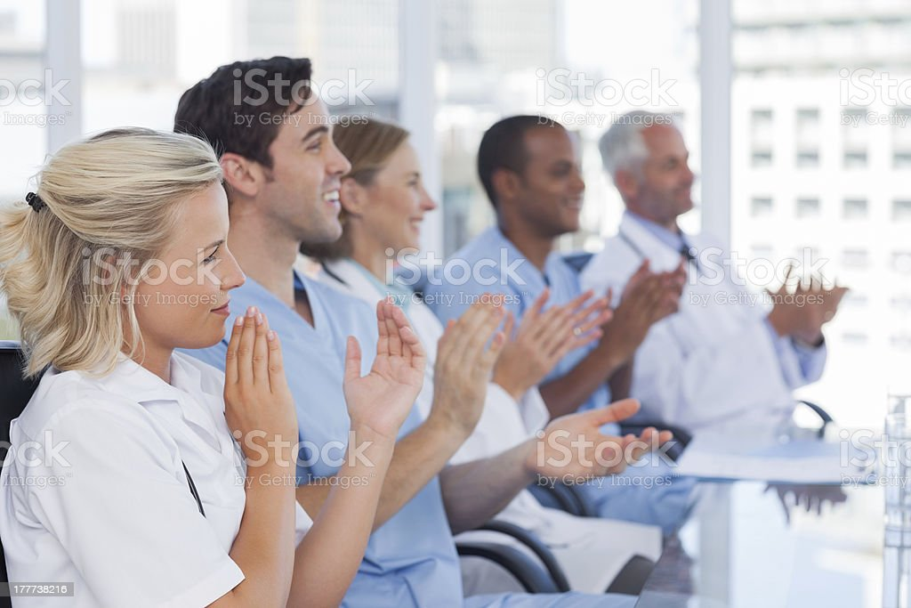 Medical team clapping hands royalty-free stock photo