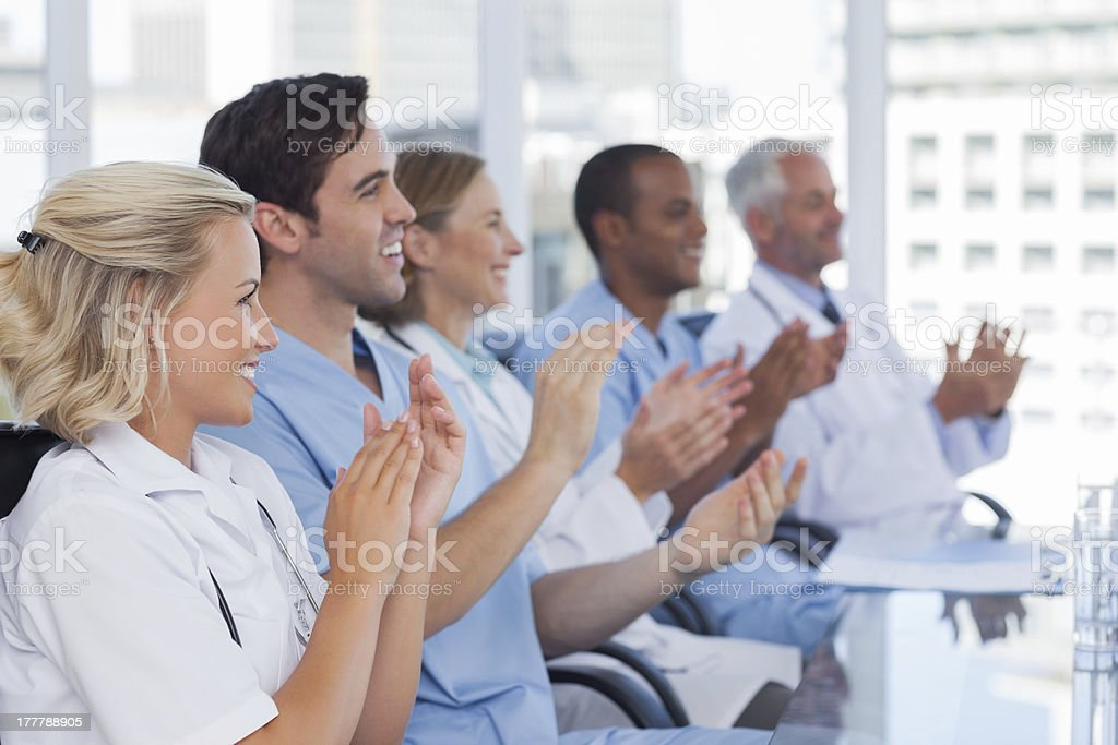 Medical team clapping  their hands royalty-free stock photo