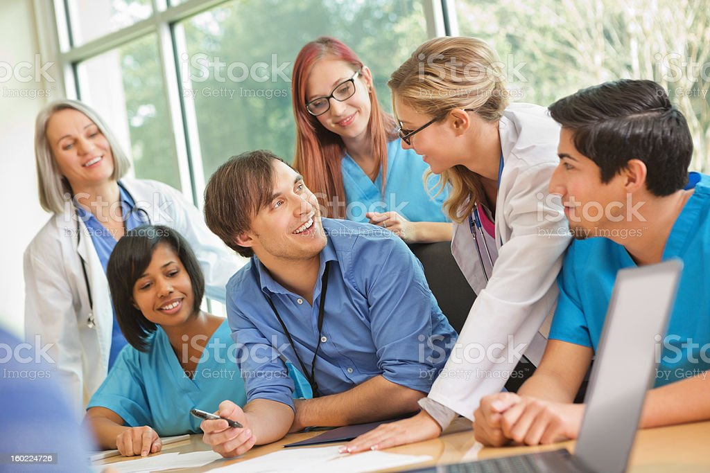 Medical team consulting together doing research for diagnosis royalty-free stock photo