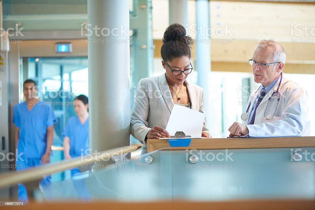medical team discussing a case stock photo