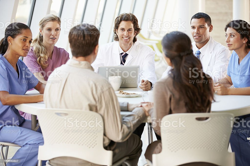 Medical Team Discussing Treatment Options stock photo