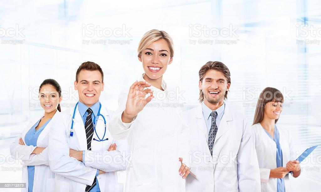 medical team doctor team show pill stock photo