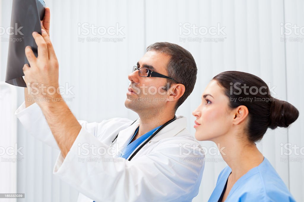Medical team examining X-ray image royalty-free stock photo