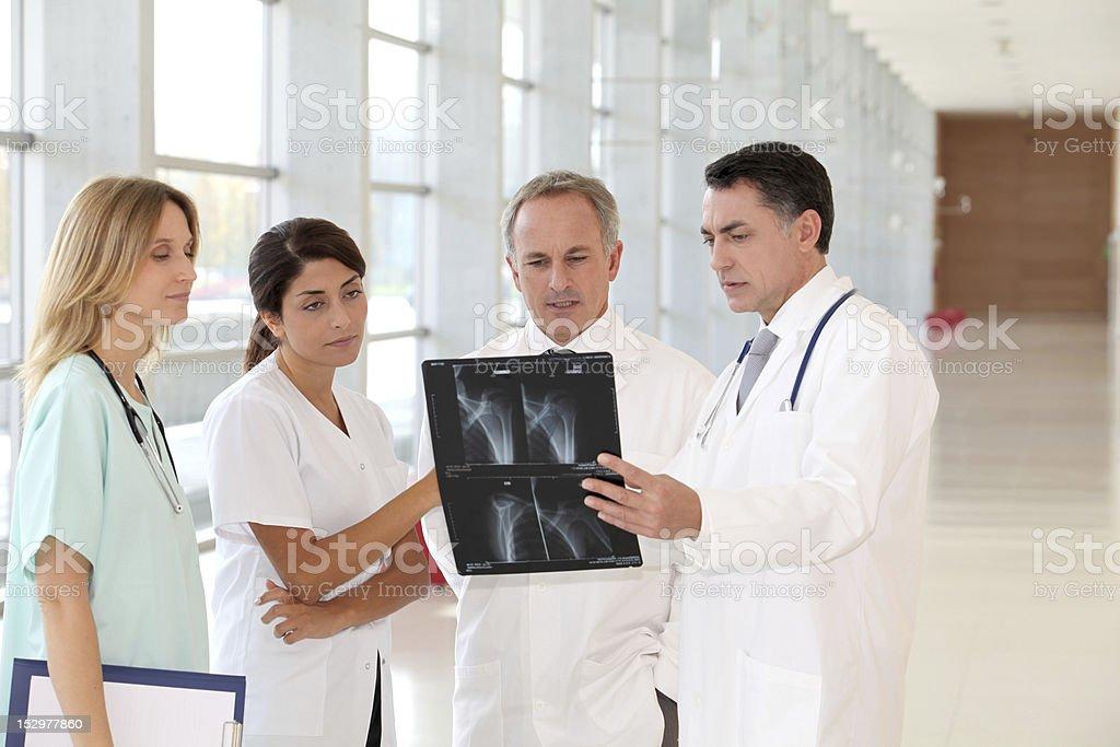 Medical team examining X-ray stock photo