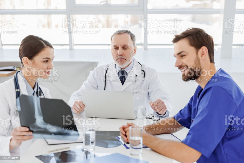 Medical team gathering council about human health stock photo