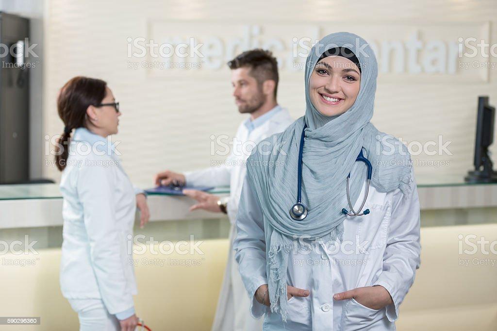 Medical team in different races standing indoor stock photo