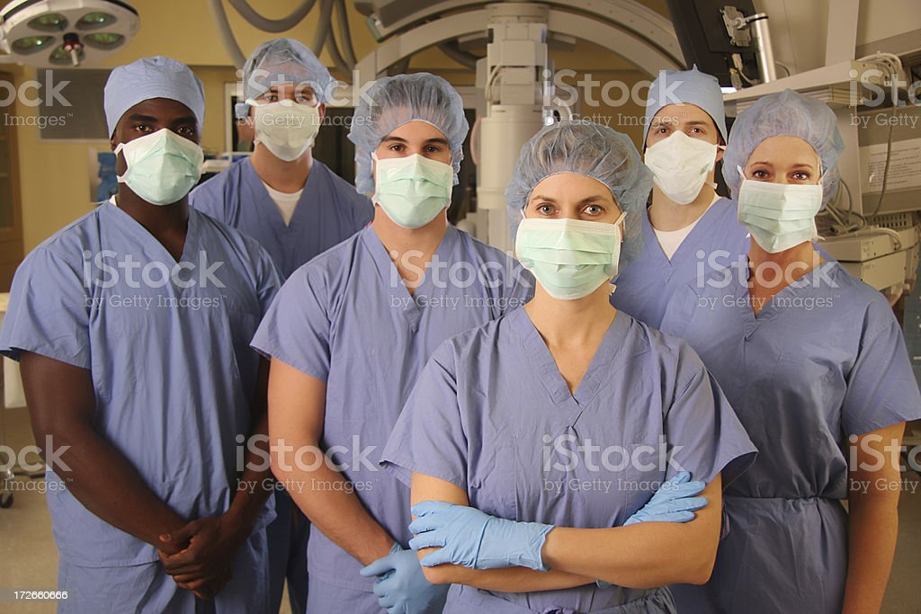 Medical Team in Operating Room - Serious 1 royalty-free stock photo