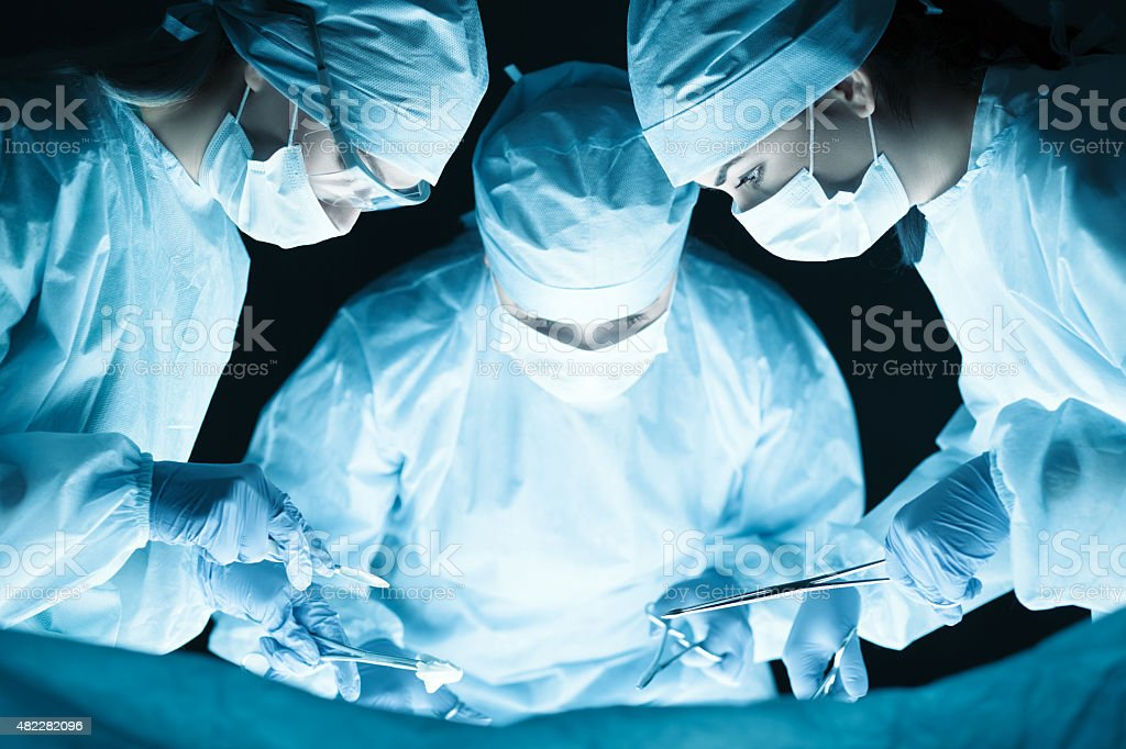 Medical team performing operation stock photo