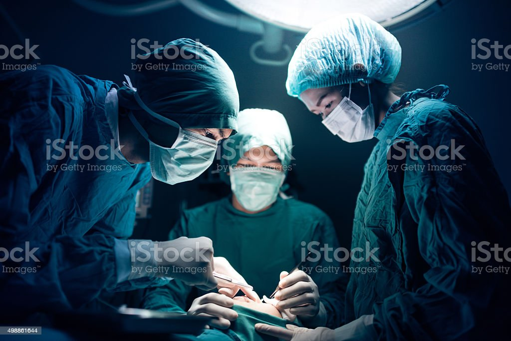 Surgical team working on a patient in operating theater