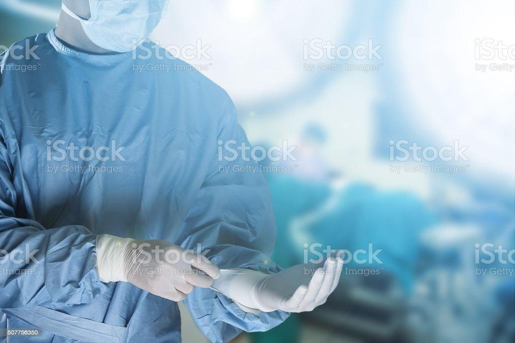 Medical team preparing equipment for surgery stock photo