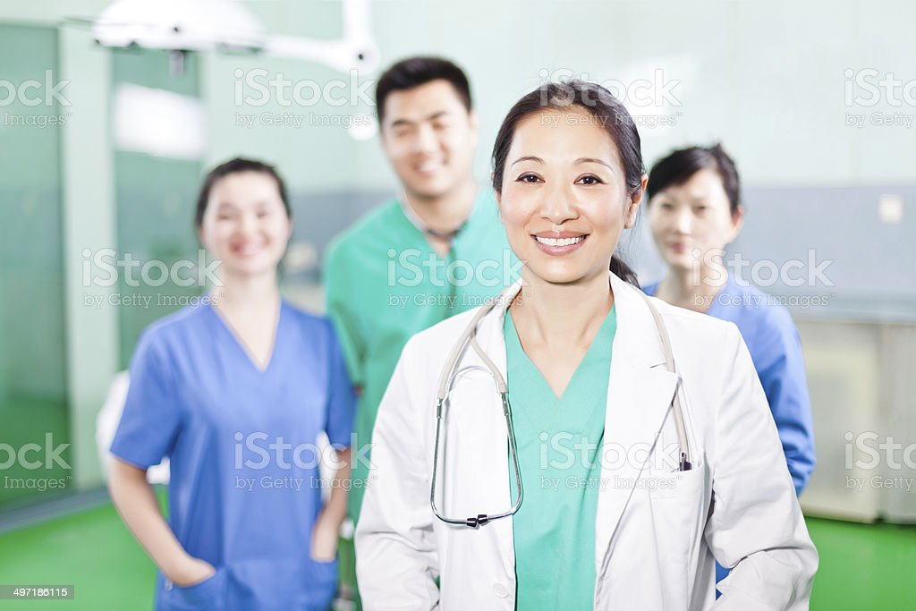 Medical team standing in the operating room stock photo