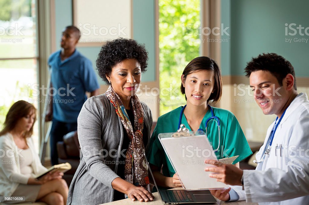 Medical team talking with patient stock photo