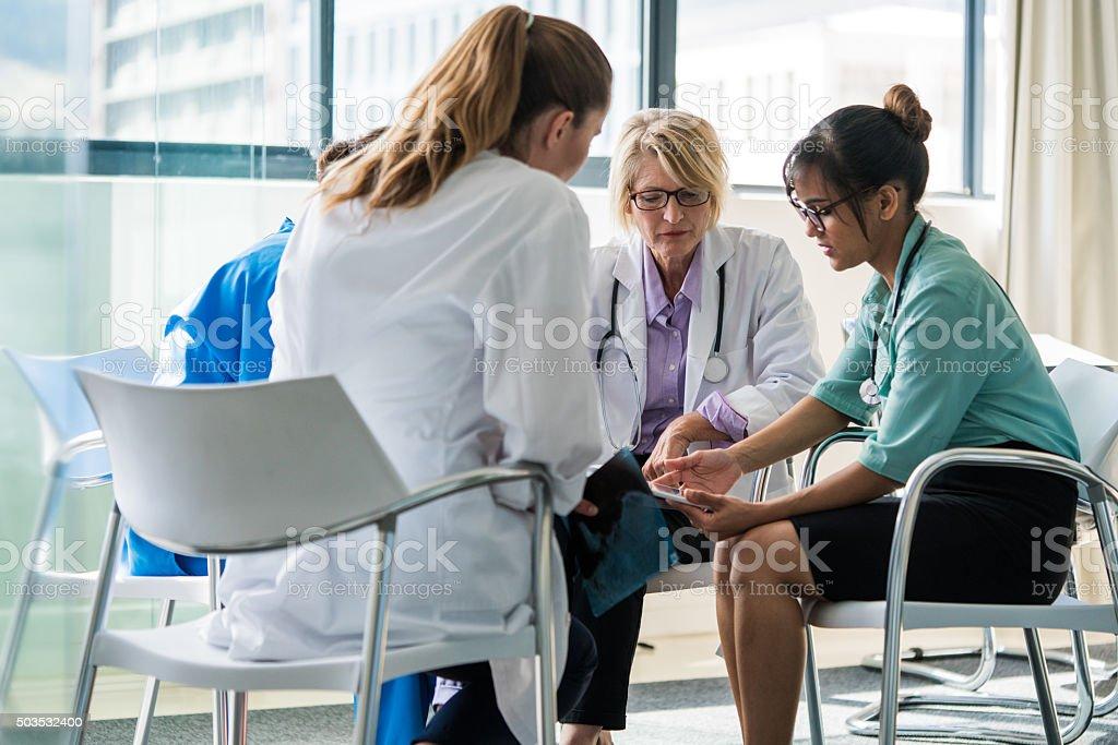 Medical team using digital tablet in hospital stock photo