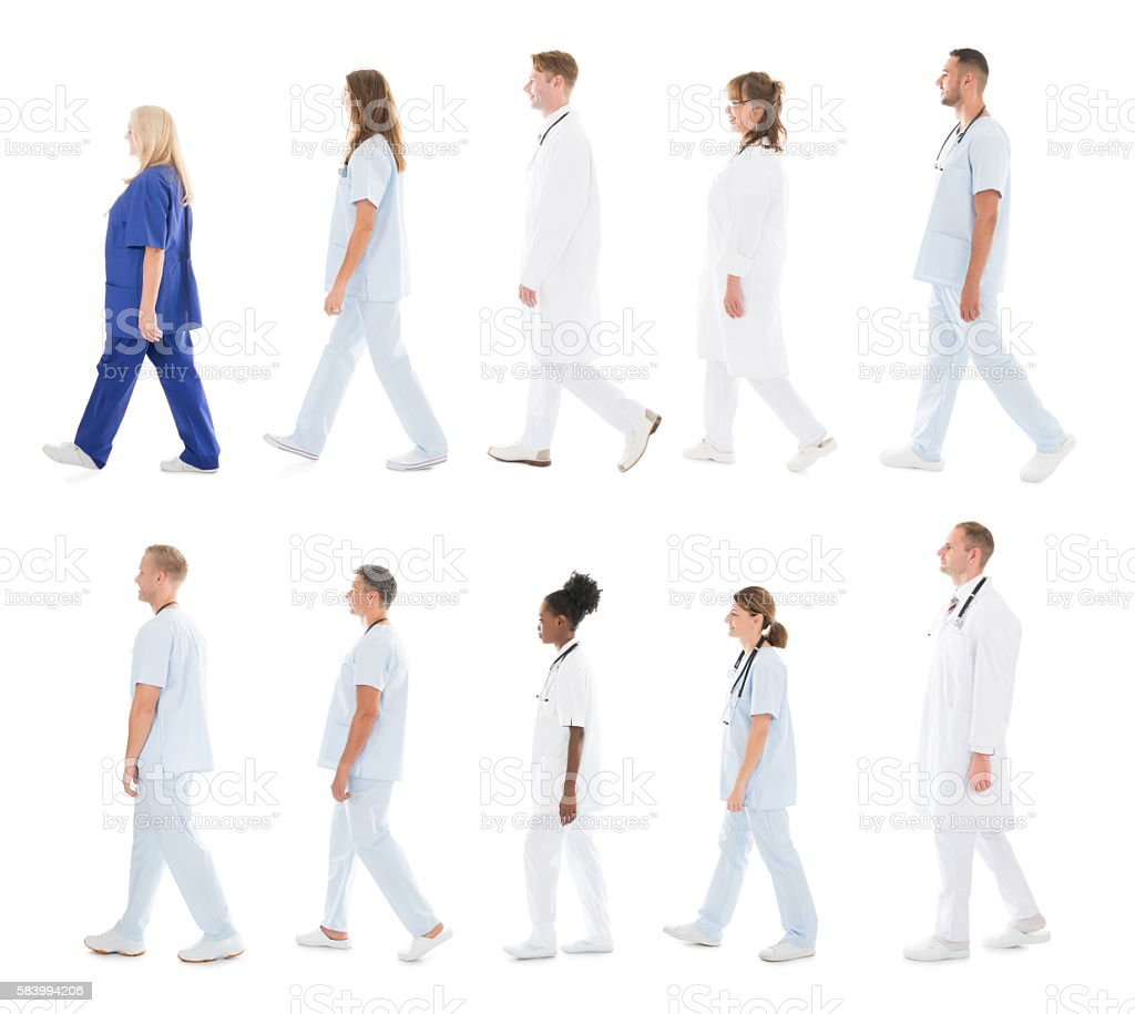 Medical Team Walking In Row stock photo