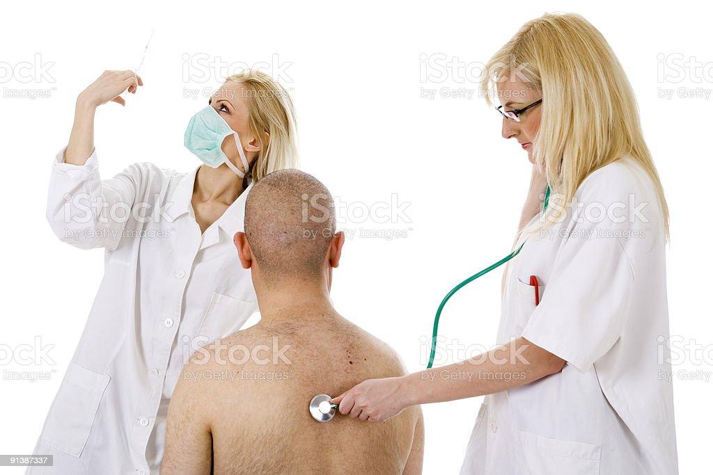 medical team with nurse holding syringe royalty-free stock photo