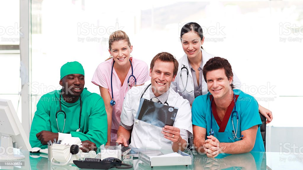 Medical team working together in hospital royalty-free stock photo