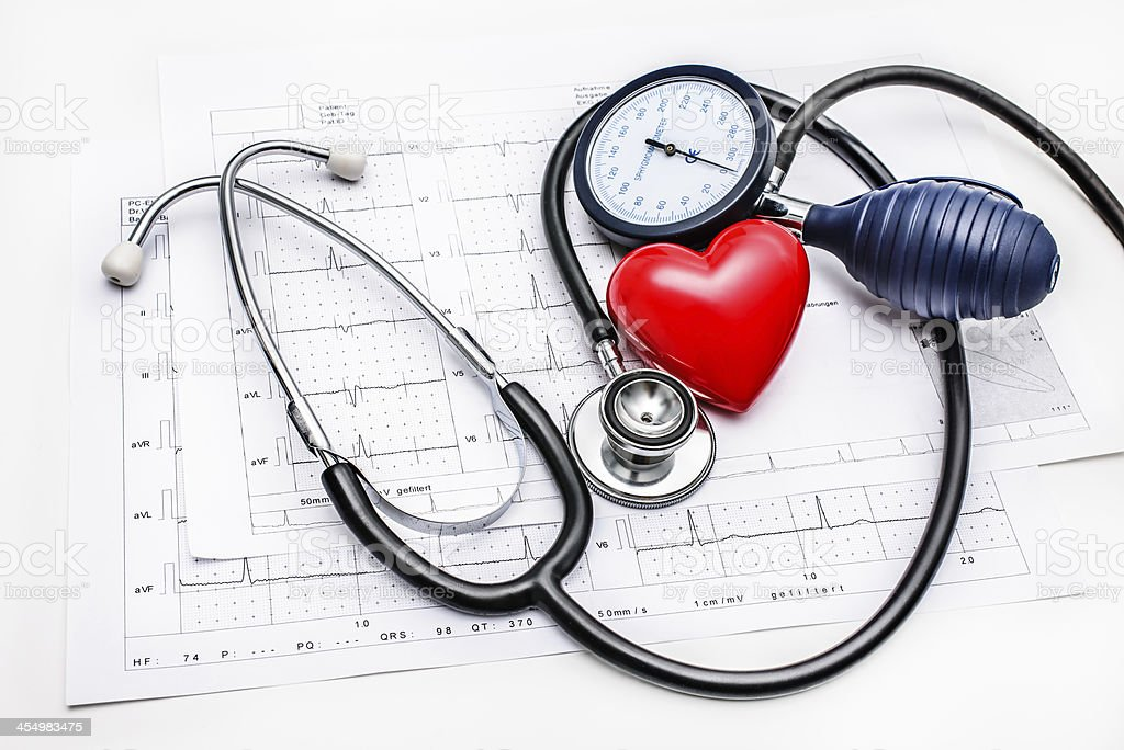 Medical tools lying on ECG stock photo