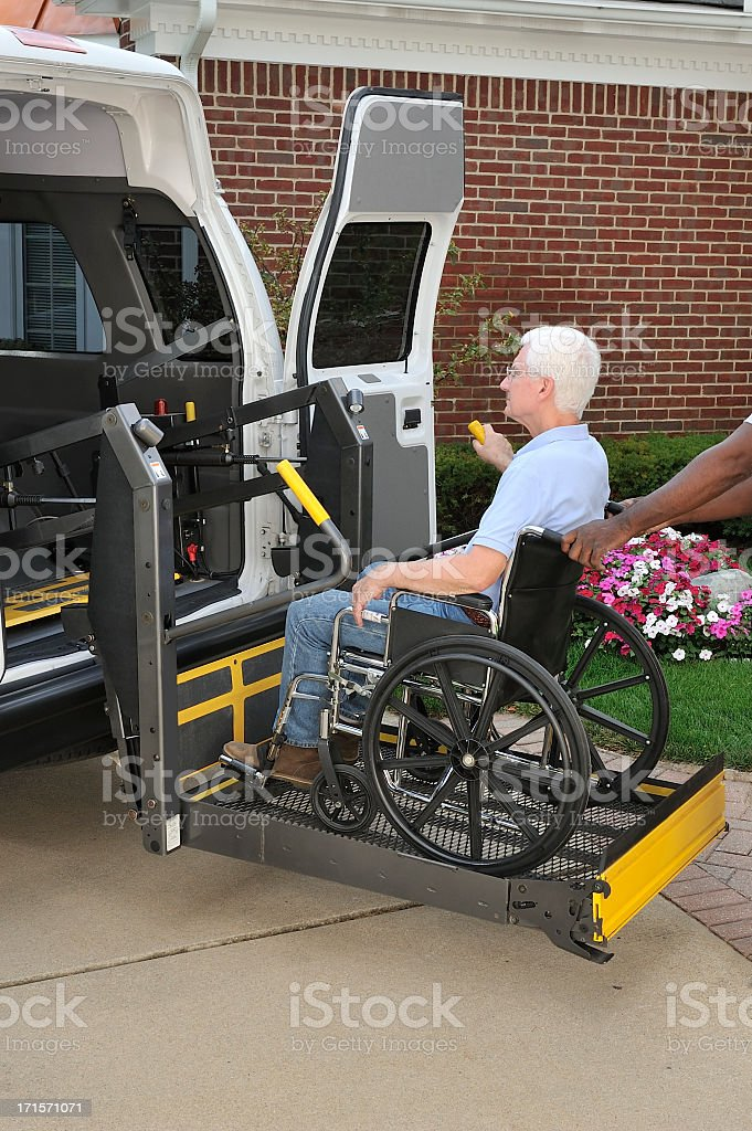Medical transport van with mechanical lift stock photo