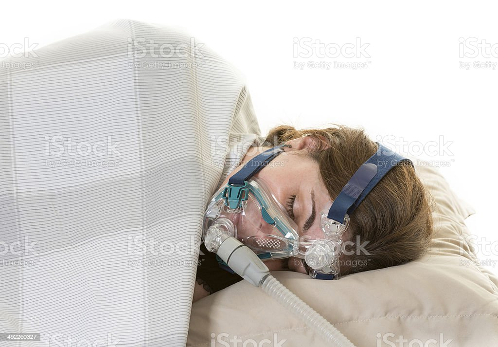 Medical treatment for sleep apnea in a woman stock photo