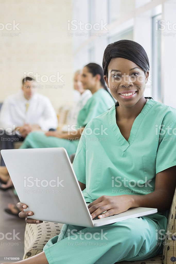 Medical worker sitting with her laptop stock photo