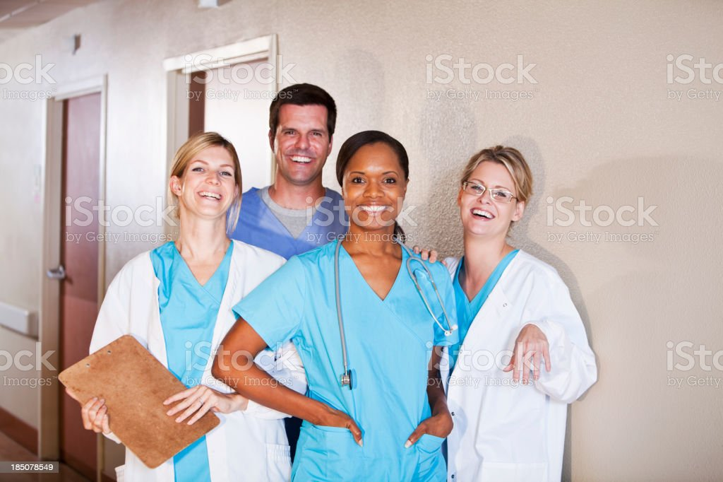 Medical workers standing in hospital corridor stock photo