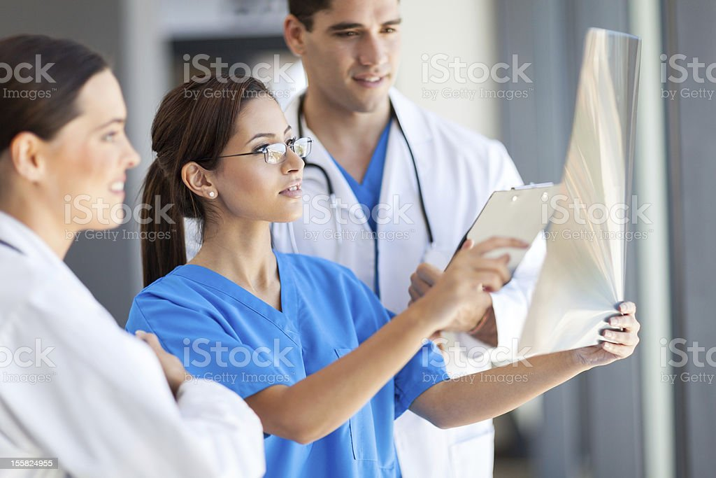 medical workers working together in hospital stock photo
