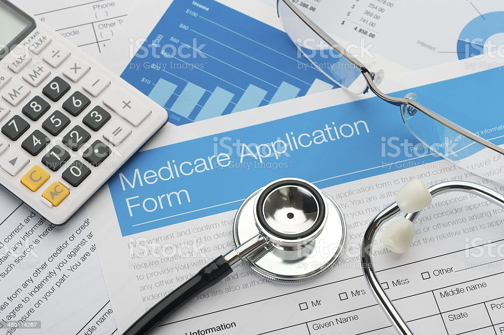 Medicare application form with stethoscope stock photo