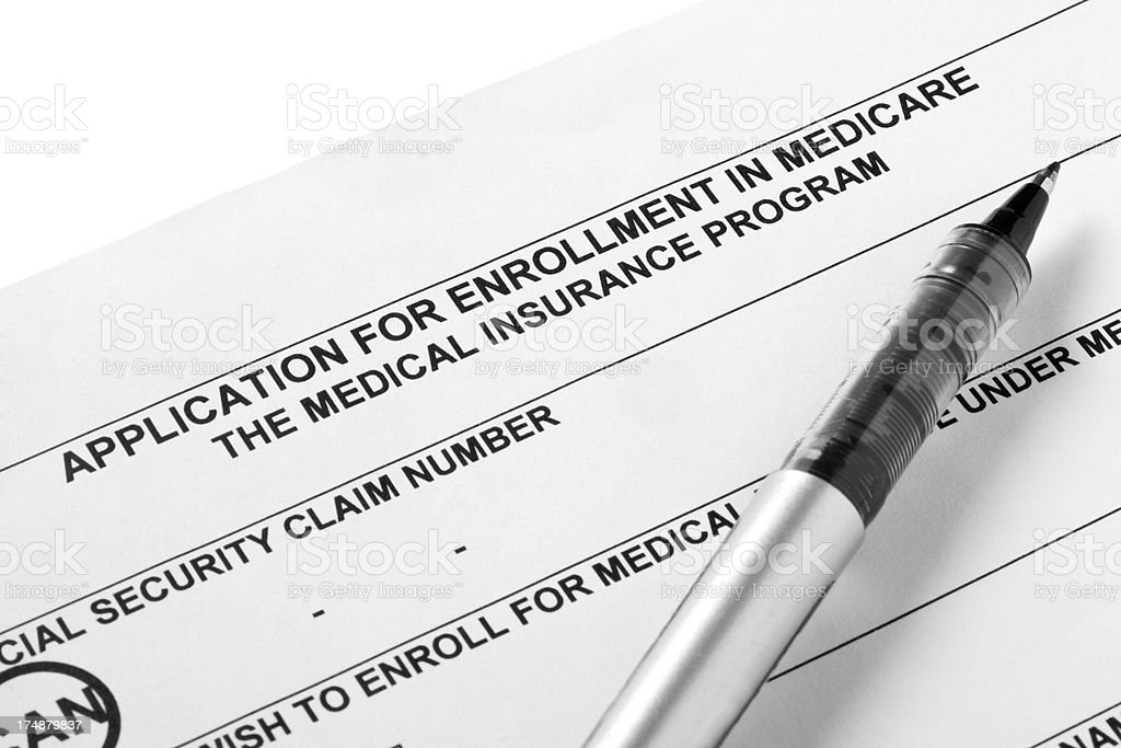 Medicare  Application with pen royalty-free stock photo