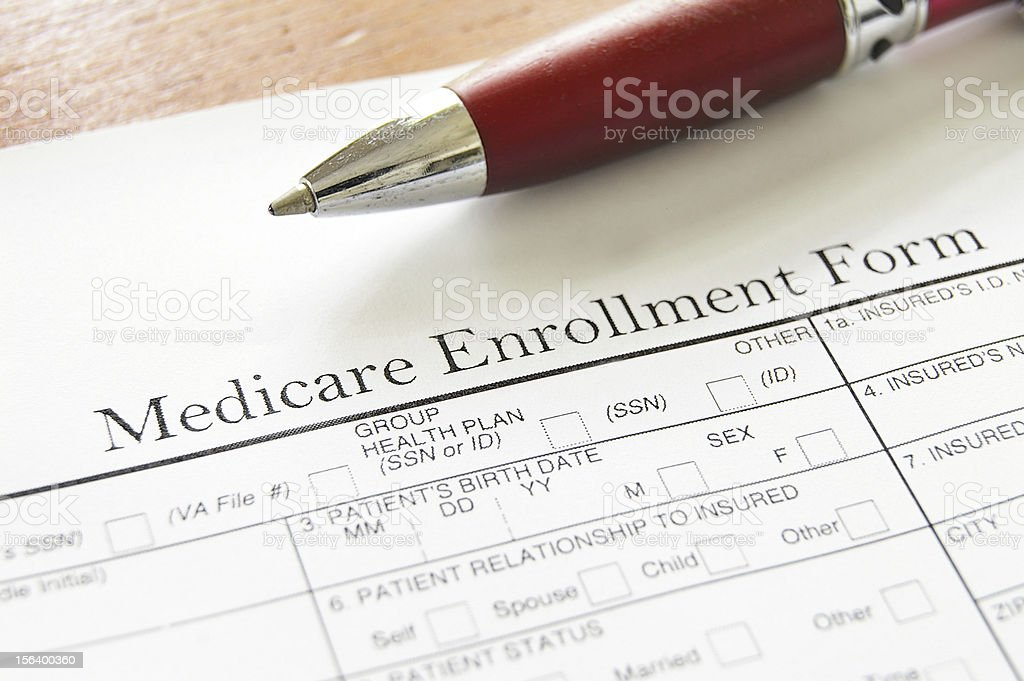Medicare Enrollment Form and a red pen royalty-free stock photo