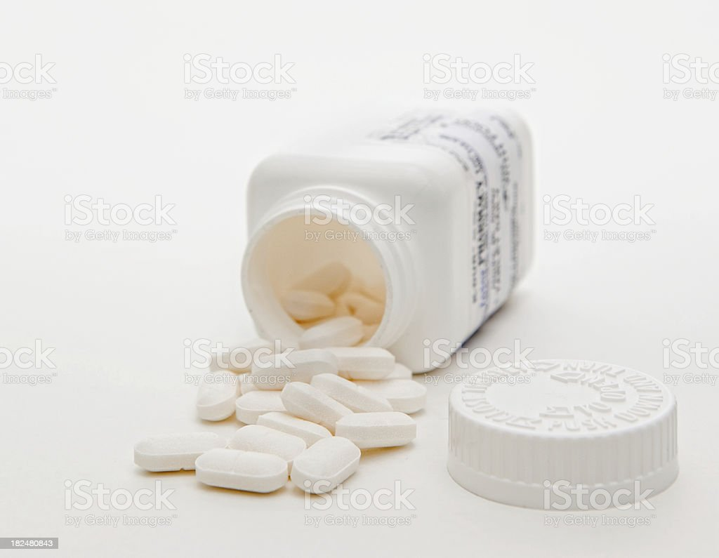 Medication and Container on white background stock photo