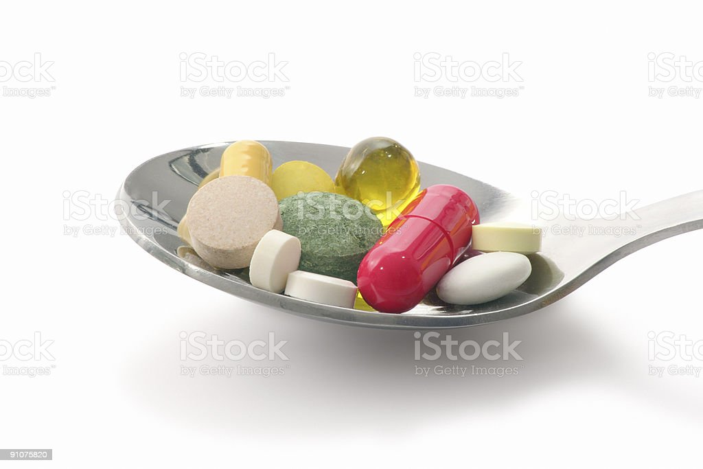 Medications in spoon royalty-free stock photo