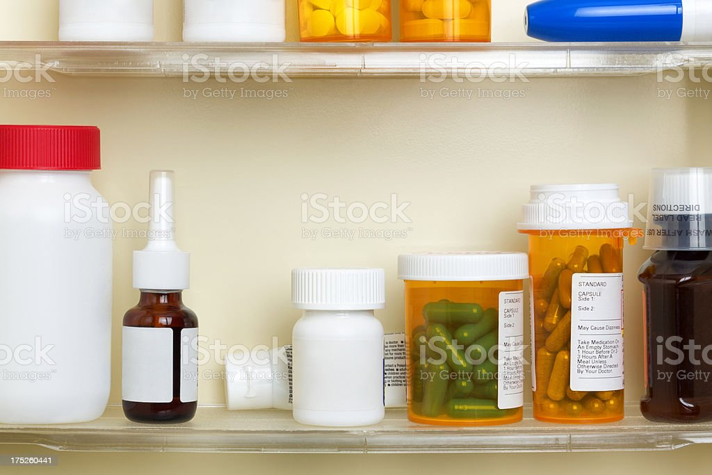 Medications on the Shelves of a Medicine Cabinet royalty-free stock photo