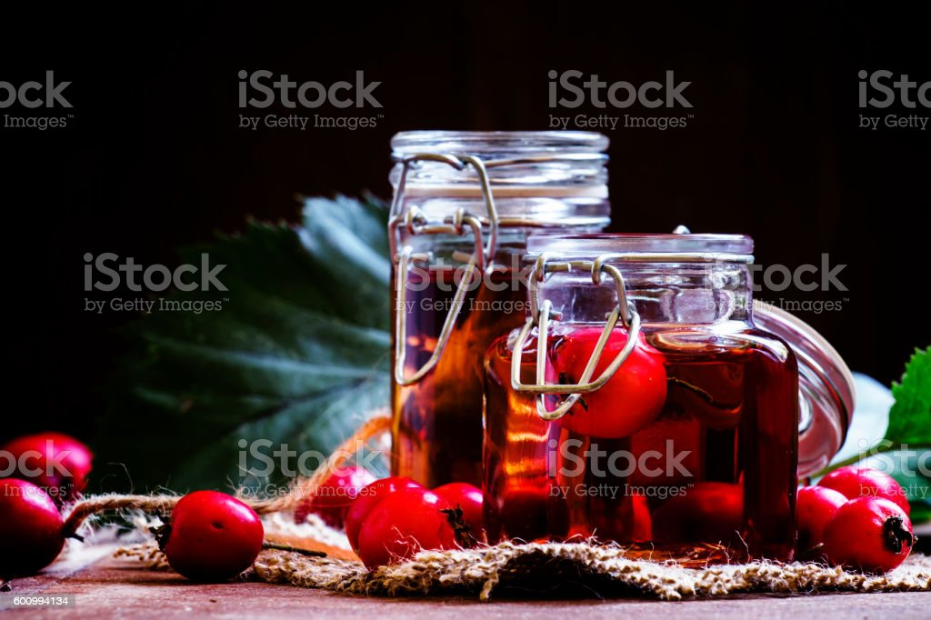 Medicinal alcoholic tincture of hawthorn berries stock photo