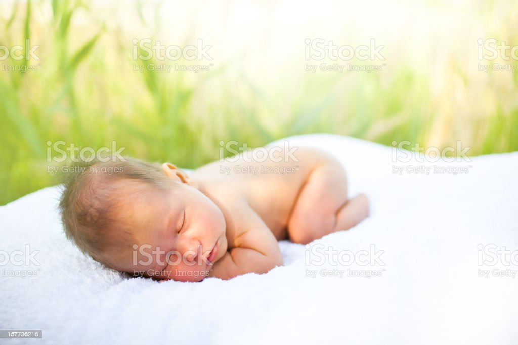 Medicinal sunbaths for baby stock photo