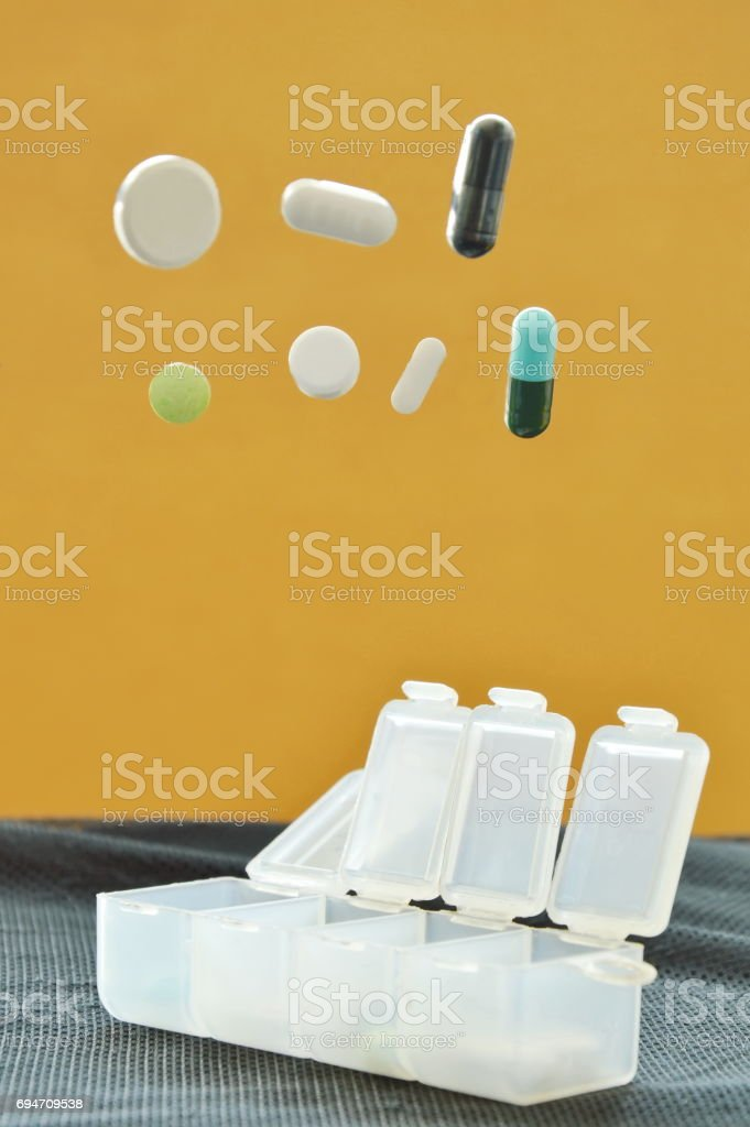 medicine and capsule dropping to plastic cartridges stock photo