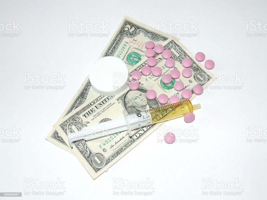 Medicine and money stock photo