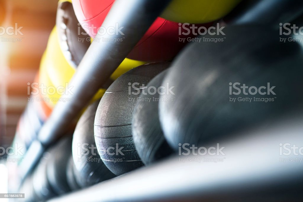 Medicine balls on shelf in modern gym. stock photo