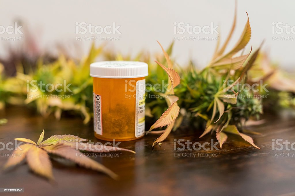 Medicine bottle filled with medical marijuana ready for patient pickup stock photo