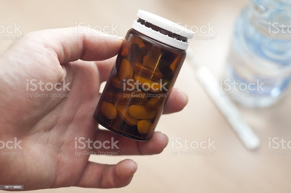 Medicine bottle in hand stock photo