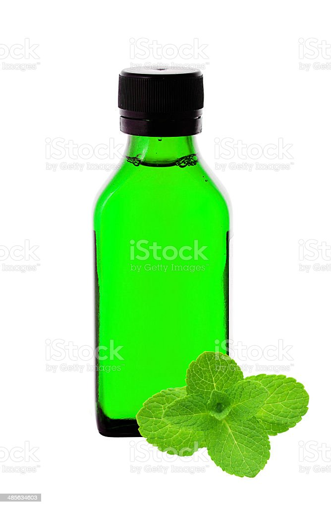medicine bottle with green syrup and mint herb stock photo